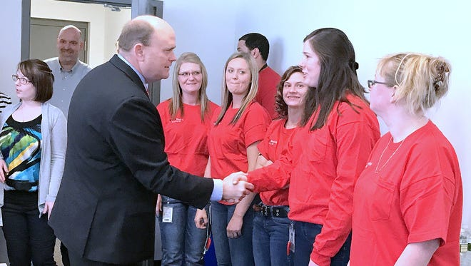 U.S. Rep. Tom Reed greets employees at the CVS Health warehouse/distribution center in Chemung on Thursday.