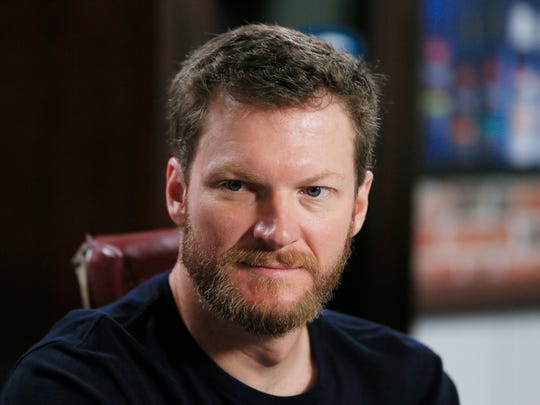 """Dale Earnhardt Jr., is seen during a news conference for Suave Men """"Speed and Style Salon"""" at Michigan International Speedway, Friday, June 12, 2015, in Brooklyn, Mich."""