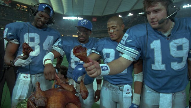 Victory never tasted better for the Lions on Nov. 23, 1995. Star offensive standouts, from left, Herman Moore, Brett Perriman, Scott Mitchell and Johnnie Morton celebrated their Thanksgiving win over the Vikings.