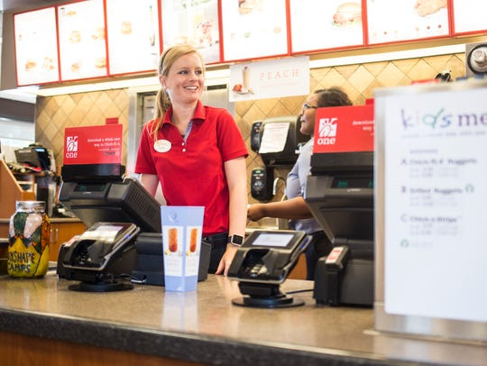 A cashier at the Chick-Fil-A on East Greenville Street