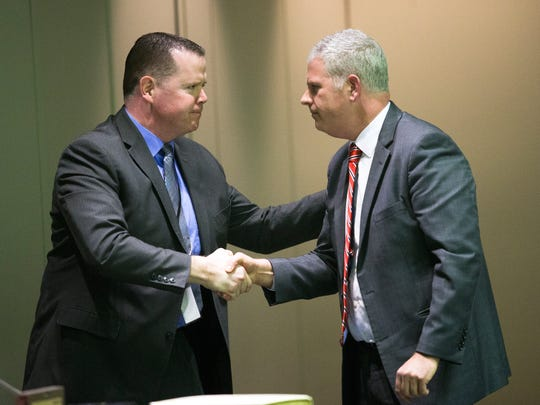 Broome County Executive Jason Garnar, right, shakes hands with Chair of the Legislature Dan Reynolds, left, after delivering his State of the County speech on Thursday, Feb. 16, 2017.