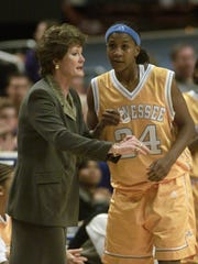 Coach Pat Summitt, left, talks to Lady Vols forward Tamika Catchings during the national championship game on April 2, 2000.