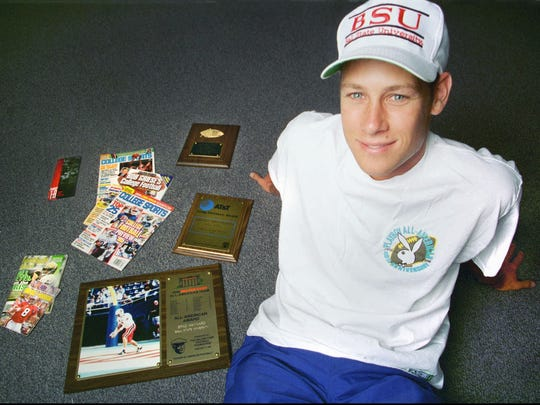 FILE – Brad Maynard poses with All-American plaques and publications, including his Playboy 40th anniversary preseason All-American T-shirt.