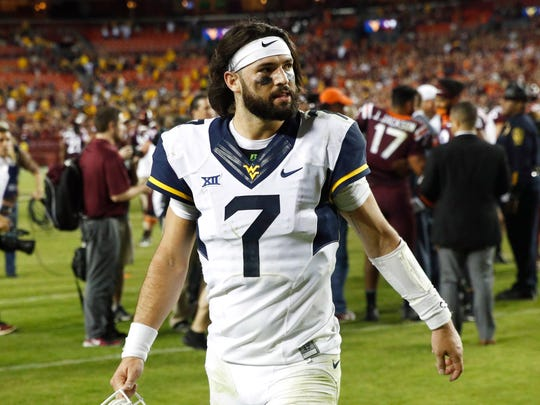 West Virginia quarterback Will Grier threw for 3,490 yards and 34 touchdowns last season.