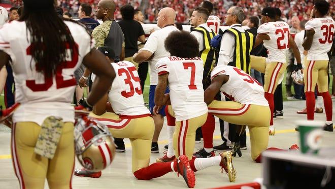 San Francisco 49ers quarterback Colin Kaepernick kneels during the national anthem on Nov. 13, 2016 in Glendale, Ariz.