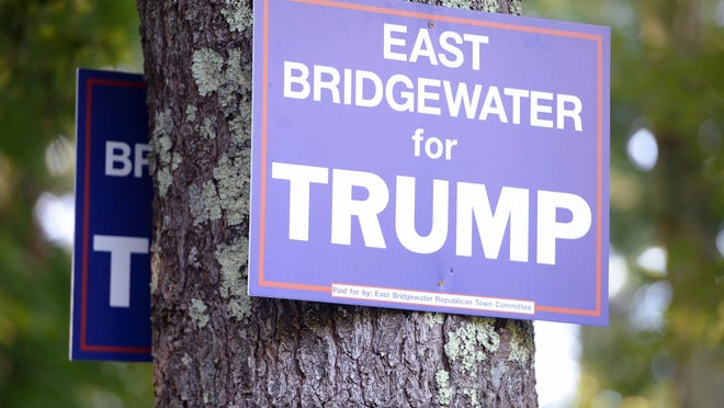 A rash of thefts of signs in support of President Donald Trump have been taking place throughout the town of East Bridgewater, on Wednesday, Aug. 26, 2020. These signs on Elm Street are nailed to a tree.