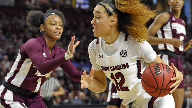 South Carolina's Brea Beal (12) drives while defended by Mississippi State's Myah Taylor (1) in a March 8, 2020 game. South Carolina is ranked No. 1 in the AP poll released Tuesday.