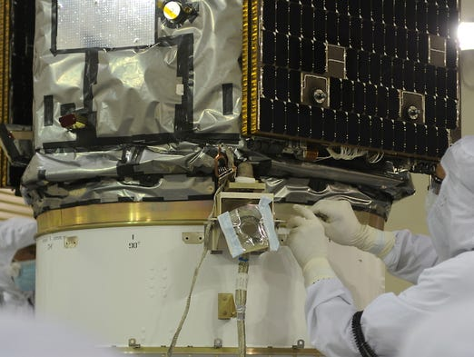 A technician prepares NASA's Orbiting Carbon Observatory-2 inside a clean room in the Astrotech Payload Processing Facility at Vandenberg Air Force Base in California.