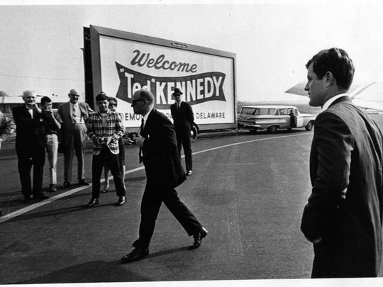 "In this image captured by News Journal photographer Bill Snead, U.S. Sen. Edward ""Ted"" Kennedy (right) is shown arriving at the Greater Wilmington Airport in May 1966 to speak at the Jefferson-Jackson Day Banquet during his first visit to Delaware. Snead died Sunday at his home in Kansas."