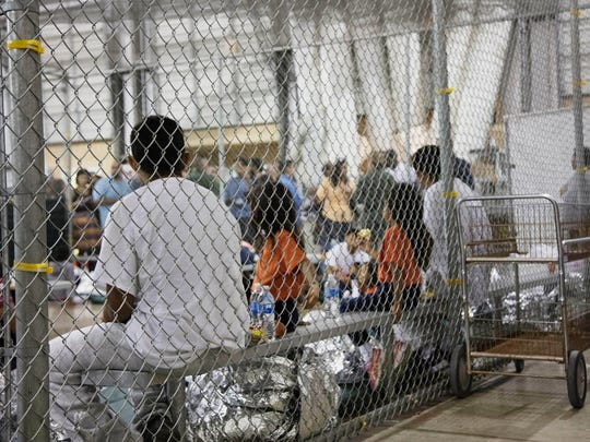 Immigrant families in a detention facility in McAllen,