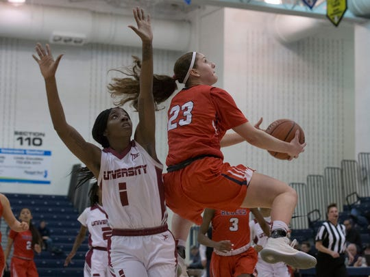 Saddle River Day's Michelle Sidor (23) runs under the basket and then up with a shot as University's Danielle Robinson watches. University High vs Saddle River Girls Basketball in NJSIAA quarterfinal game at Toms River on March 14, 2018