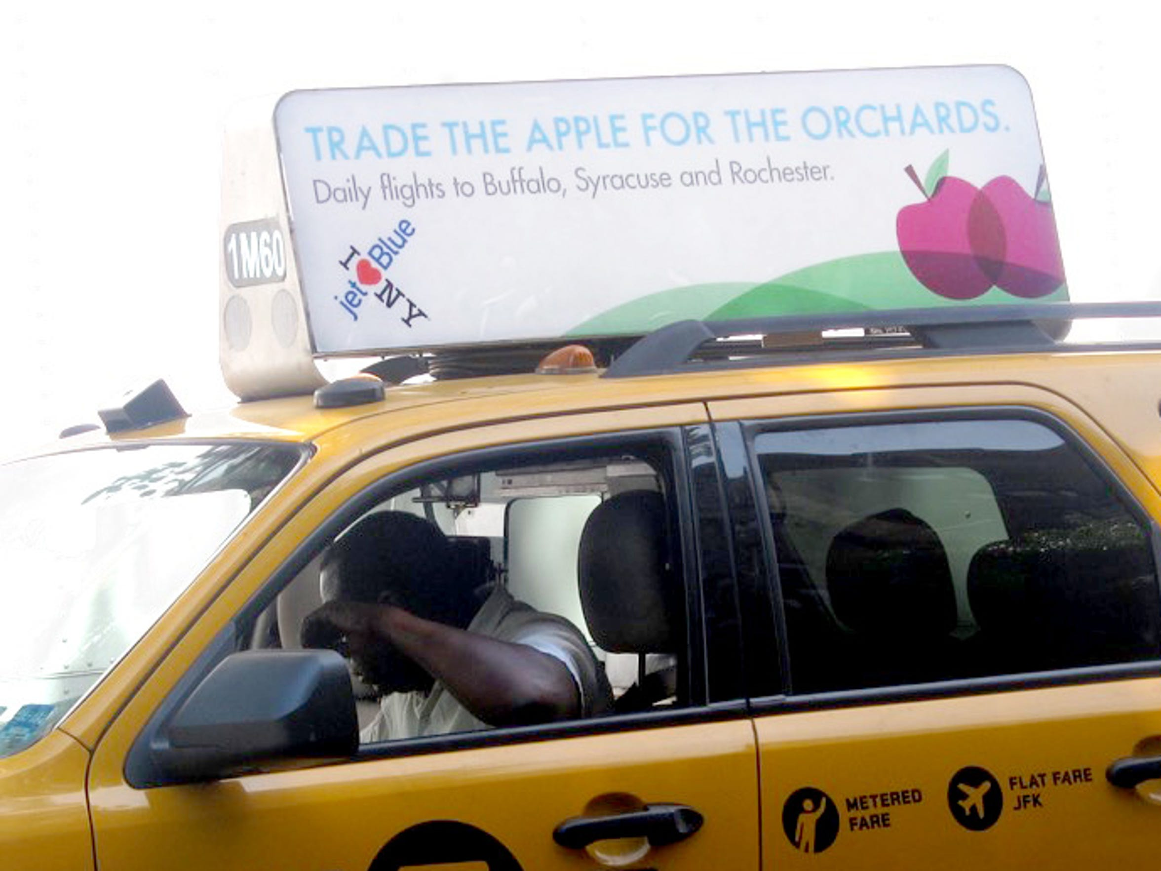 The ad above the taxi seemed to be meant for her.