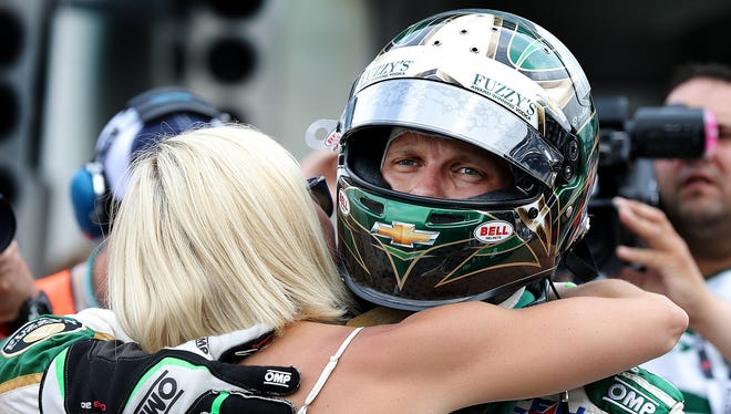Ed Carpenter (20) of CHF Racing hugs his wife Heather following his qualification attempt for the 99th Indianapolis 500 Sunday, May 17, 2015, morning at the Indianapolis Motor Speedway.