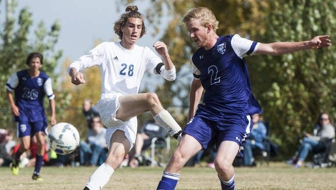 Great Falls' Hayden Van Son and Butte's Travis Williams go after a loose ball during the game at Siebel Soccer Complex Saturday.