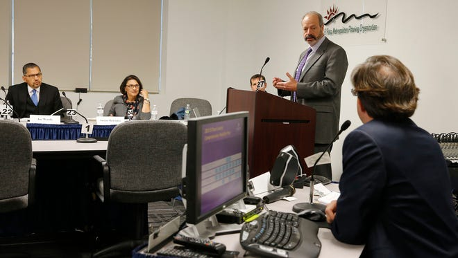 El Paso Mayor Oscar Leeser address the CRRMA board during it's meeting after their executive session that lasted almost two hours to discuss several items on the groups agenda. Here Leeser asks a question of Raymond Telles, Executive Director of the CRRMA about the accounting of funds that Telles oversees for several ongoing projetcs, specifically the streetcar project.The CRRMA held a special meeting to discuss the oversight of project funds, as it relates to the streetcar project.