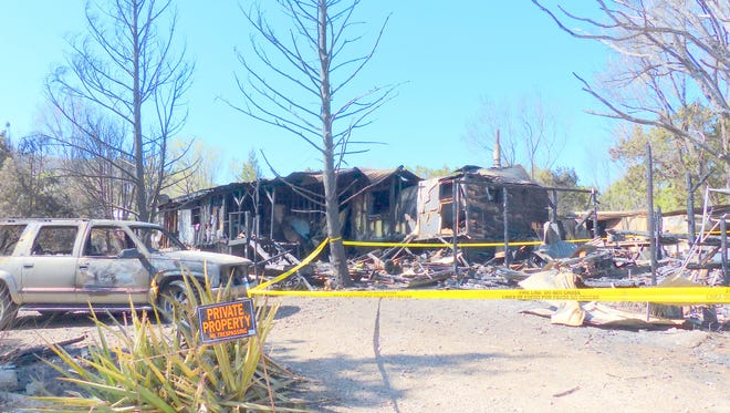 The property destroyed by fire on North Parnell in Ruidoso Downs is taped off to discourage trespass.