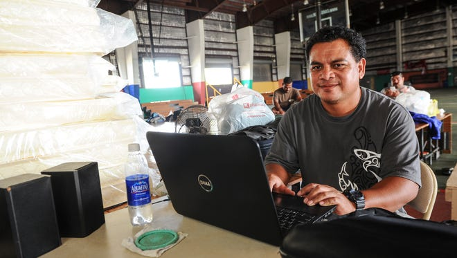 With an abundance of bedding mattresses and a laptop to keep him occupied, Kosraean delegate member, Nena William, still manages to sport a smile as he and four fellow delegates spend time at their temporary housing at the the Astumbo gym in Dededo on Wednesday, May 18.