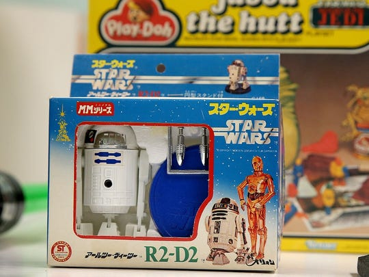 "The ""Star Wars"" archives at the Children's Museum of Indianapolis include toys from Japan, including this die-cast R2-D2 made in 1978. For unknown reasons, the Takara Orion company gave its metal droid the ability to fire plastic missiles. Today, online sellers seek more than $150 for this toy."