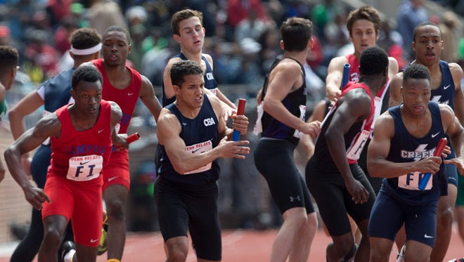 CBA's Tim Jacoutot hands off to teammate Mike Zupko during Boys 4x400 trials.Saturday events at Penn Relays in Philadelphia Pa, on April 30, 2016.