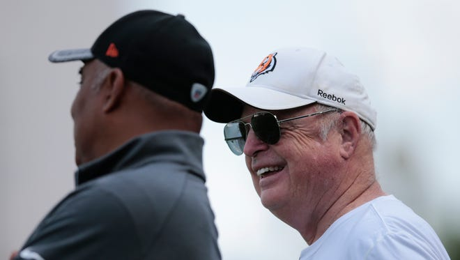 Cincinnati Bengals president Mike Brown, right, talks to head coach Marvin Lewis, right, during Cincinnati Bengals rookie mini camp, Friday, May 6, 2016, on the practice fields adjacent to Paul Brown Stadium in Cincinnati.