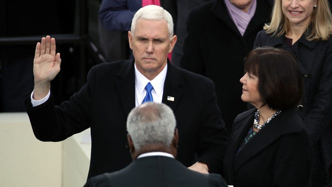 U.S. Vice President Mike Pence takes the oath of office on the West Front of the U.S. Capitol in Washington, D.C., on Jan. 20, 2017.