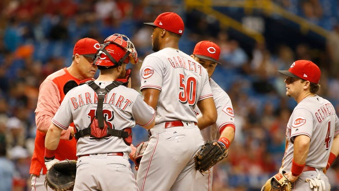 Cincinnati Reds manager Bryan Price (38) comes to the mound to take out  Cincinnati Reds starting pitcher Amir Garrett (50) during the fourth inning against the Tampa Bay Rays at Tropicana Field.