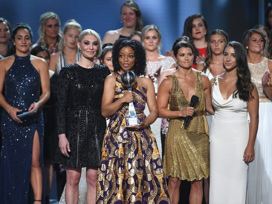 "Host Danica Patrick joins Sarah Klein, Tiffany Thomas Lopez, Aly Raisman and other ""sister survivors"" of Larry Nassar's sexual abuse who were recipients of the Arthur Ashe Award for Courage at ""The 2018 ESPYS."""