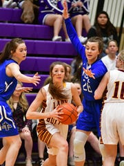 Madison's Anna Theophilus (center) looks to pass as