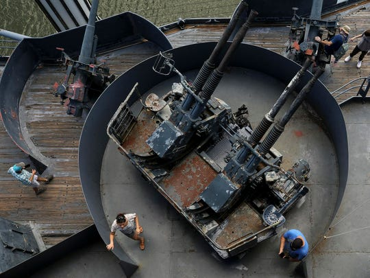 People explore Battleship Texas on Sunday in the Houston area. The ship served both World War I and World War II.