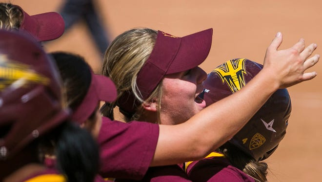 The ASU softball team celebrates their win on a walk-off single at a home game against Oregon State on April 19, 2015 in Tempe.