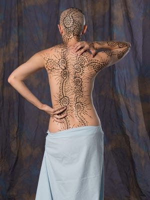 Anna Cowley Ford, a 28-year-old Eastland artist, recently applied henna to her entire body to show where she experiences discomfort, including from migraines and chronic pain. She is using her body as a canvas to raise awareness of the invisible suffering she and others feel every minute of the day.