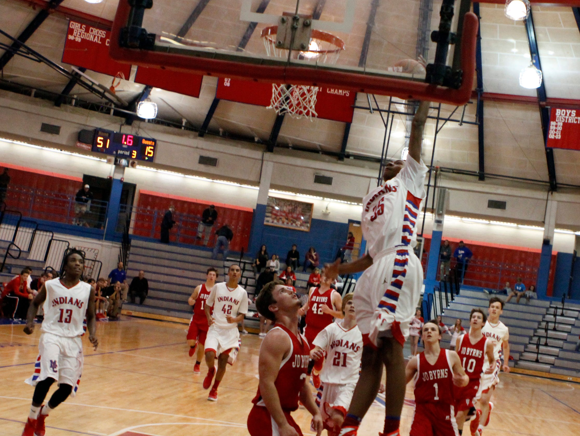 Trey Spencer went for the slam on a fast break against the Jo Byrns Red Devils Friday. The Indians won their season opener 55-20.