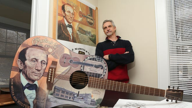 Rutherford resident and artist Robert Geotzl has designed the artwork for the 2 millionth Martin Guitar to be unveiled on January 18, 2017. He has designed for them before as well. Robert is photographed on January 9, 2017.