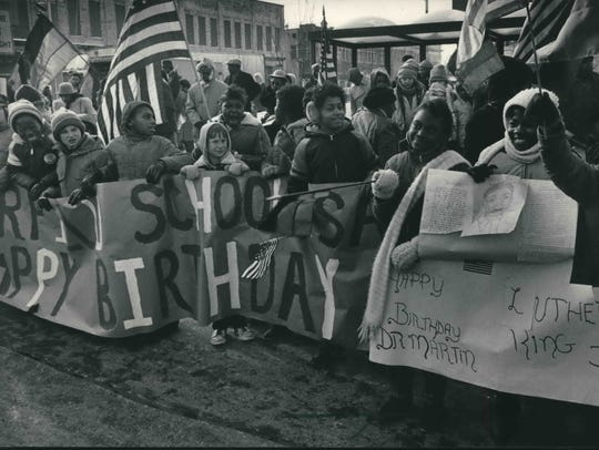 In 1985 schoolchildren gather for a ceremony to rename N. 3rd St. to Dr. Martin Luther King Jr. Drive