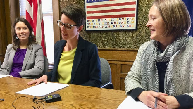 Democrats Jenny Eck, center, Amanda Frickle, left and Moffie Funk discuss the upcoming statewide elections on Monday at the Montana Democratic Party headquarters.