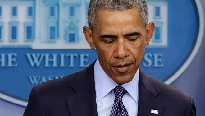 President Barack Obama makes a statement on the mass shooting at an Orlando, Florida nightclub in the White House Briefing Room in Washington, DC on June 12, 2016.