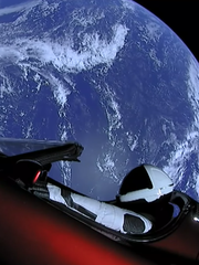 """Starman,"" a mannequin in the Tesla Roadster, floats"