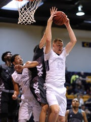Hardin-Simmons' Justin Jones (40) pulls down a rebound during the second half of the Cowboys' 87-83 win on Saturday, Jan. 21, 2017, at HSU's Mabee Complex.