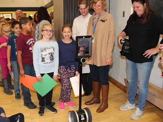 Tiernan Kriner, 8, has a serious genetic disease but is able to participate in classroom activities at Maine Memorial Elementary thanks to a a telepresence robot, iPad and Chromebook. Here, he is pictured at the school's recent Grandparent's tea.