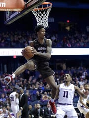 Brown guard Desmond Cambridge, left, looks to pass as Northwestern guard Anthony Gaines watches hime during the first half of an NCAA college basketball game, Saturday, Dec. 30, 2017, in Rosemont, Ill. (AP Photo/Nam Y. Huh)