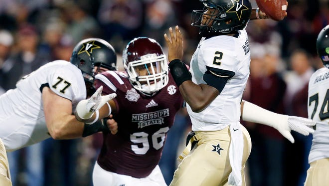 Vanderbilt quarterback Johnny McCrary (2) is pressured by Mississippi State defensive lineman Chris Jones (96) as he throws an incomplete pass in the first half of an NCAA college football game Saturday, Nov. 22, 2014, in Starkville, Miss. (AP Photo/Rogelio V. Solis)