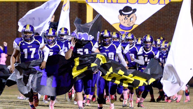 Waynesboro breaks through the banner and heads for the sidelines for the start of a football game against Fort Defiance High School played in Waynesboro on Friday, Oct. 24, 2014.