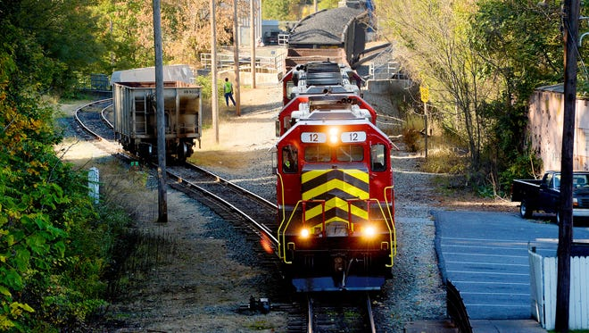 A Buckingham Branch Railroad locomotive moves rail connects with railway cars near the train station in downtown Staunton on Thursday, Oct. 9, 2014.