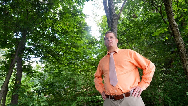 An August file photo of Churchville landowner William Little II, who filed a lawsuit to keep surveyors for Dominion from entering his property. Little stands under trees he fears might be removed by Dominion, just a few feet from where they have proposed running their natural gas pipeline near Churchville.