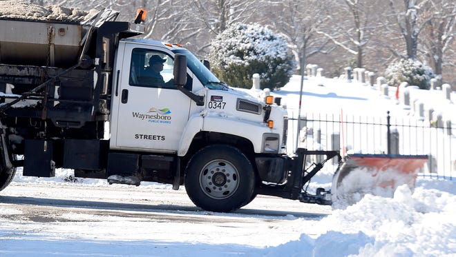 A snowplow pushes snow clear of an intersection in Waynesboro.