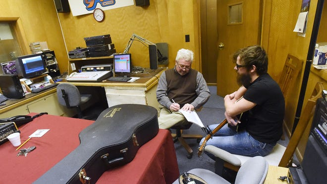 Radio host John Huggins goes over the planned flow of the forthcoming show with musician Bryan Elijah Smith, who is the week's guest, before they begin recording the week's edition of Shenandoah Valley Local Music Hour at Star 94 in downtown Staunton on Thursday, Feb. 26, 2015.