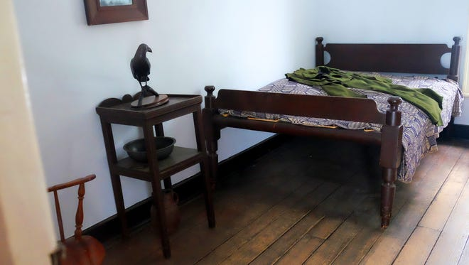 The old dorm room once used by Edgar Allan Poe when he was a student at the University of Virginia is preserved by the Raven Society.