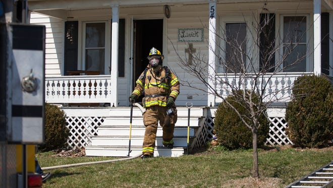 Firefighters from Grottoes, Augusta County, New Hope, Weyers Cave, Rockingham County and McGaheysville responded to the scene of a fire at a home off of Rockfish Road in Grottoes on Monday, March 23, 2015.