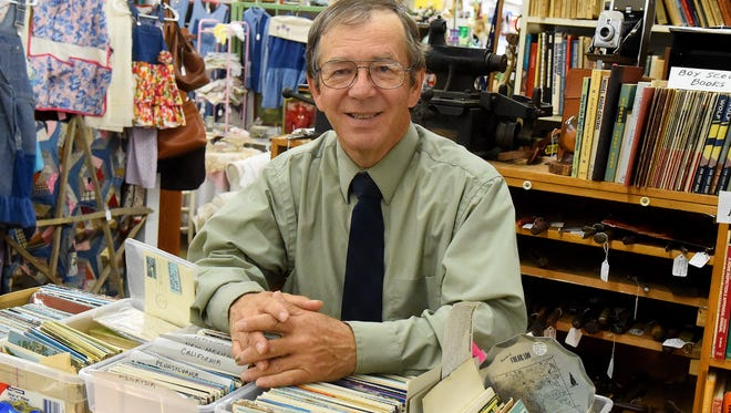 Robert Swope is photographed within one of the booths he maintains with his wife inside the Factory Antique Mall in Verona on Wednesday, April 29, 2015. An author, Swope's passions include antiques, history and photography.
