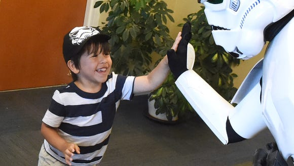 Wearing a Stormtrooper hat, Westly Strosnider, 4, of